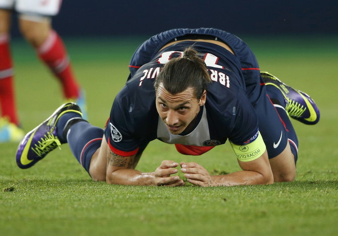 Paris Saint-Germain's Ibrahimovic reacts after scoring against Benfica during their Champions League soccer match in Paris