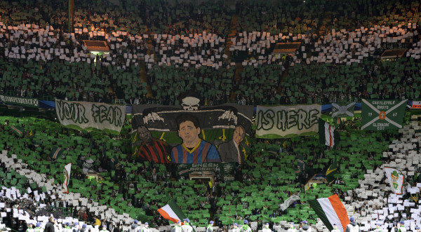 Celtic supporters hold up banners before their Champions League soccer match against Barcelona at Celtic Park in Glasgow