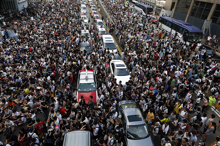 Traffic stands still as tens of thousands of protesters jam the main street leading to the financial Central district outside the government headquarters in Hong Kong