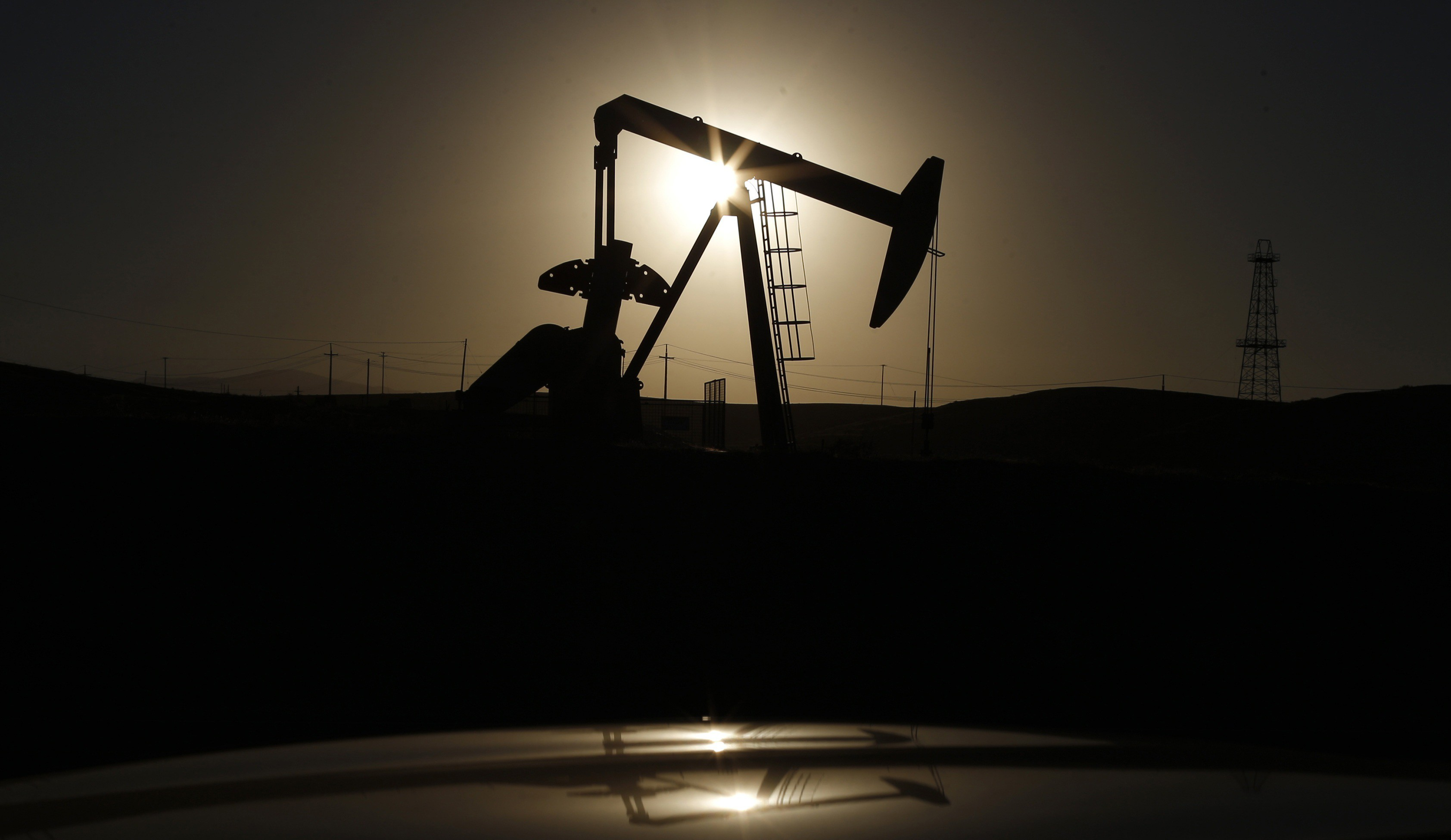 File photo of a pump jack at sunrise near Bakersfield