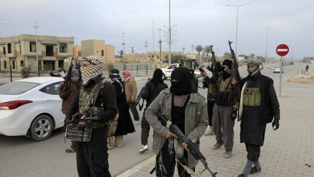 Armed tribesmen deployed on the streets take control of the city of Ramadi