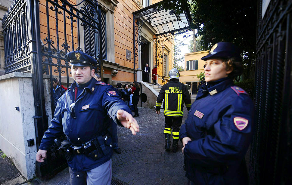 Italian policemen control as they work a