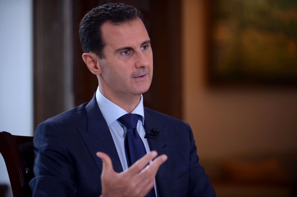 "A handout picture released by the official Syrian Arab News Agency (SANA) on July 14, 2016 shows Syrian President Bashar al-Assad speaking during an interview with American NBC News channel in the capital Damascus. Assad said in an interview released on July 14, 2016 that US reporter Marie Colvin, who was killed in alleged government fire in 2012, was ""responsible"" for her own death, when asked if Colvin was responsible for her death in shelling of the rebel-held city of Homs, he replied ""of course"", though he denied in the interview with NBC News that his forces had targeted her directly. / AFP PHOTO / SANA / -"