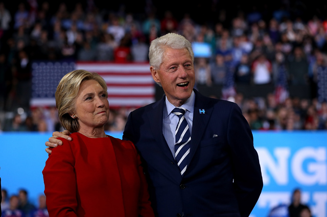 RALEIGH, NC - NOVEMBER 08: Democratic presidential nominee former Secretary of State Hillary Clinton (L) and her husband former U.S. President Bill Clinton look on during a campaign rally at North Carolina State University on November 8, 2016 in Raleigh, North Carolina. The midnight rally followed Clinton campaigning in Pennsylvania, Michigan and North Carolina in the lead up to today's general election. (Photo by Justin Sullivan/Getty Images)