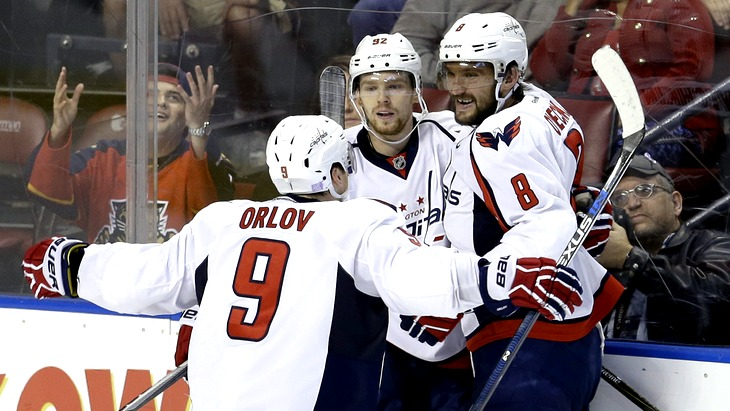 Washington Capitals defenseman Dmitry Orlov (9) and Alex Ovechkin (8) congratulate Evgeny Kuznetsov (92) after Kuznetsov scored the game-winning, 2-1, goal against the Florida Panthers in overtime of an NHL hockey  game, Saturday, Oct. 31, 2015, in Sunrise, Fla. (AP Photo/Alan Diaz)