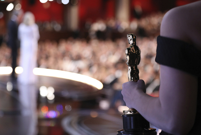 One of the best picture Oscar statuettes appears off stage as Warren Beatty and Faye Dunaway announce the best picture winner at the Oscars on Sunday, Feb. 26, 2017, at the Dolby Theatre in Los Angeles. (Photo by Matt Sayles/Invision/AP)