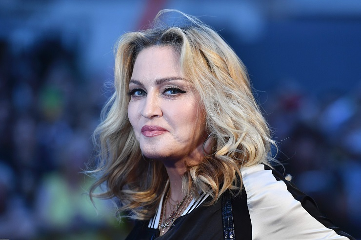 "US singer-songwriter Madonna poses arriving on the carpet to attend a special screening of the film ""The Beatles Eight Days A Week: The Touring Years"" in London on September 15, 2016. / AFP PHOTO / Ben STANSALL"